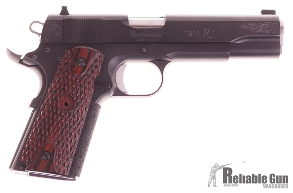 Picture of Used Remington 1911 R1 Centennial Semi-Auto .45ACP, With 2 Mags & Original Box, Grip Medallion Missing, Otherwise Good Condition