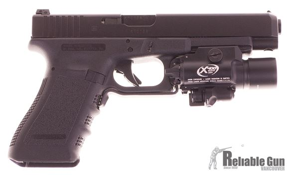 Picture of Used Glock 35 Gen 3 Semi Auto Pistol, 40 S&W, Black, Adjustable Rear Sight, Surefire X400 Light Laser Combo, 10 magazines, Holster, Very Good Condition, No Box