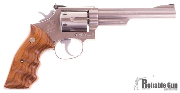Picture of Used Smith & Wesson Model 66-1 357 Magnum Revolver, 6'' Stainless, 6 Shot, Deluxe Wood Grips With Finger Grooves, Adjustable Rear Sight, Leather Holster, Very Good Condition