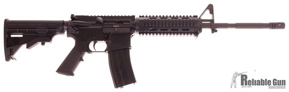 "Picture of Used Bushmaster XM15-E2S Semi-Auto 5.56mm, 16"" Barrel, With YHM Quad Rail, One Mag, Excellent Condition"