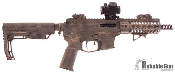 "Picture of Used Angstadt Arms AA-0940 Semi-Auto 9mm, 5.5"" Barrel, With Bushnell TRS-25 Red Dot Sight, Muzzlebrake, Troy Flip Up Sights, BCM Charging Handle, Camo Paint Job, 4 Mags, Good Condition"
