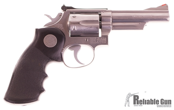 "Picture of Used Smith & Wesson Model 66-1 Double-Action 357 Mag, 4"" Barrel, Stainless, Hogue Grip, With Leather Holster & 2 Speed Loaders, Good Condition"