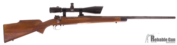 Picture of Used Flaig's Custom Mauser Bolt Action Rifle, 22-250 Rem, Wood Stock  26'' Medium-Heavy barrel, Low Pro Bolt Safety, Timney Trigger, Saxon 4-16 Scope, Very Good Condition