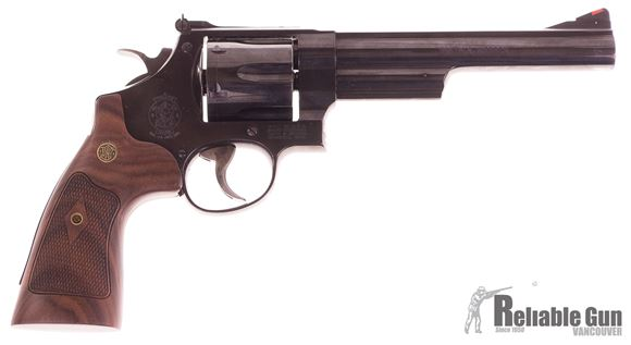 """Picture of Used Smith & Wesson Model 29 Classic Revolver, .44 Mag, 6.5"""" Blued Barrel, Wood Grips, Original Box and New Presentation Box, Small Scratch Near muzzle Otherwise Very Good Condition"""