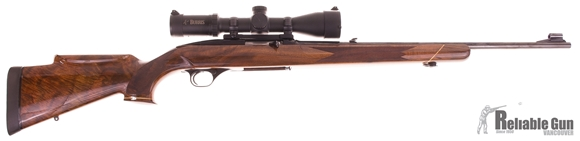 Picture of Used Winchester Model 100 Semi Auto Rifle, 308 Win, 22'' Barrel w/Sights, Deluxe Custom Wood Stock with Roll Over Cheek Piece, Rose Wood Grip Cap & Forend Cap, Burris MTAC 1.5-6 Illuminated Scope, Leupold Mounts, 1 Magazine, Plano Hard Case, Very Good Co