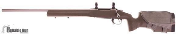"""Picture of Used Tikka T3 Varmint Bolt-Action 7mm Mag, Left Hand, 24"""" Stainless Heavy Barrel, Manners Composite Target Stock, Converted to AICS Magazine, Metal Bolt Shroud, Optilock 30mm Rings, Very Good Condition"""