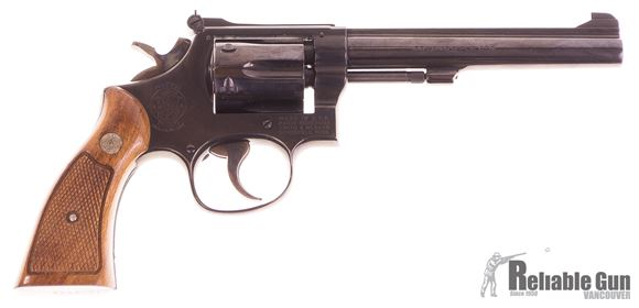 Picture of Used Smith & Wesson Model 17-4 Double Action Revolver, 6rd Cylinder, Blued, Original Wood Grip, Spare Pachmayr Large Grip, Very Good Condition