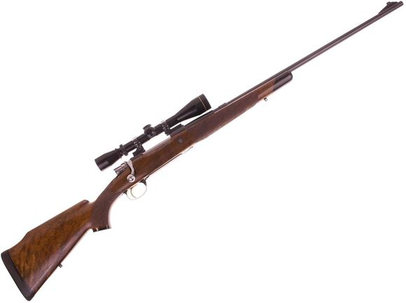 "Picture of Used Custom Rifle .264 Win Mag Bolt Action Rifle, 26"", Mauser Style Engraved FN Browning Receiver And  Engraved Bottom Metal, Winchester Barrel, Walnut Stock with End Cap, Leupold Vari-X II 3-9x40, Good Condition"