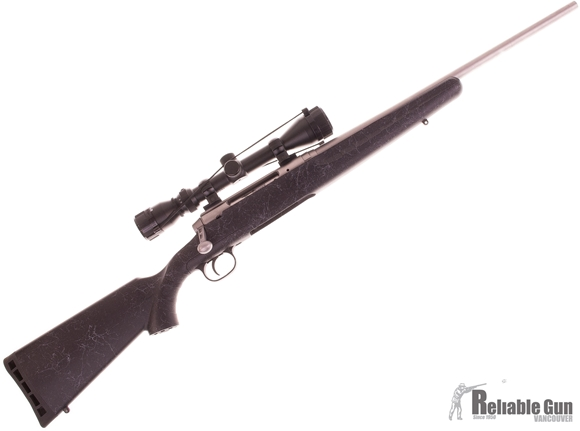 Picture of Used Savage Axis Stainless Bolt Action Rifle, 243 Win, 20'' Barrel, Bushnell 3-9x40 Scope, 2 Magazines, Excellent Condition