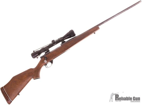 Picture of Used Smith & Wesson 1500 Bolt Action Rifle, 300 Win Mag, 24'' Barrel, Walnut Stock, Tasco Pronghorn 3-9x40 Scope, Some Bluing Wear, Good Condition