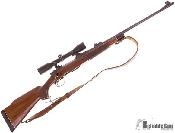 Picture of Used Remington 700 BDL DM 300 Win Mag Bolt Action Rifle, 24'' Barrel w/Sights, Walnut Stock, Zeiss Diavari C 3-9x36 MC Scope, EAW Swing off Mounts, Leather Sling, 1 Magazine, Very Good Condition