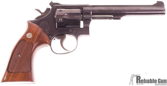 Picture of Used Used Smith & Wesson 17-3, 22 LR 6 Shot Revolver, Wood Grips, Gloss Blue, Good Condition Stamped RCMP AUX BC
