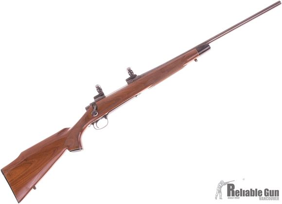 """Picture of Used Remington 700 BDL Bolt Action Rifle, 30-06 Sprg, Blued, Walnut Stock W/ End Cap, Leupold STD Scope Base, Redfield 1"""" Rings, Very Good Condition"""
