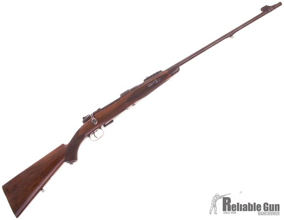 Picture of Used Westley Richards Bolt Action Rifle, Mauser 98 Action, 318 Westley Richards Accelerated Express, 26'' Barrel w/Express Sights, Walnut stock w/Ebony Forend, Spare Front Sight Blade in Pistol Grip, Made For The Earl of Egmont in 1938 with Factory Lette