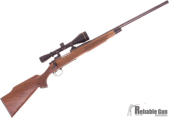 Picture of Used Remington 700 BDL Varmint Bolt Action Rifle, 22-250, 24'' Heavy Barrel, Oil Finish Walnut Stock (Minor Scratches on Top of Cheek Piece) Leupold VX-2 4-12x50 CDS Scope, Very Good Condition
