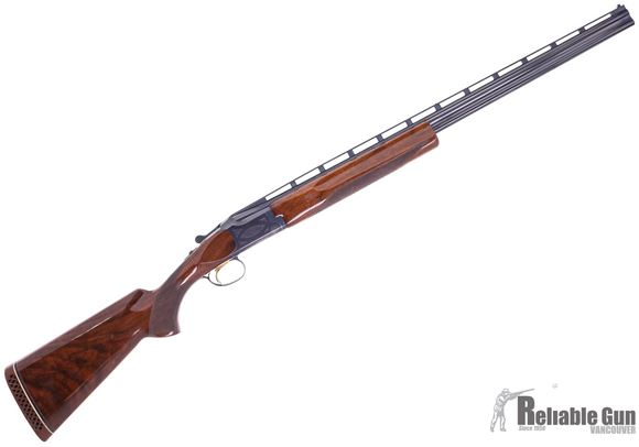 Picture of Used Browning Citori 3 Barrel Skeet Set, 20ga 28Ga 410 Bore, 28'' Barrels (Skeet Choke), Wood Stock, Blued Receiver, Bluing Wear on Receiver and Trigger Guard, w/Fitted Browning Case, Good Condition
