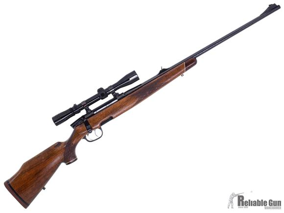 Picture of Used Steyr Mannlicher Model S Bolt Action Rifle, 7mm Rem Mag, 26'' Hammer Forged Barrel w/Sights, Double Set Trigger, Wood Stock, 1 Magazine, Redfield 3-9x40 Lo-Pro Scope, Crack on Trigger Guard, Good Condition