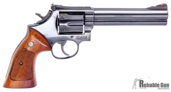 "Picture of Used Smith & Wesson 586 Double Action Revolver, 357 Mag, 6 Shot, 6"" Blued, Adjustable Rear Sight, Full Underlug, Wood Grip, Square Butt, Good Condition"